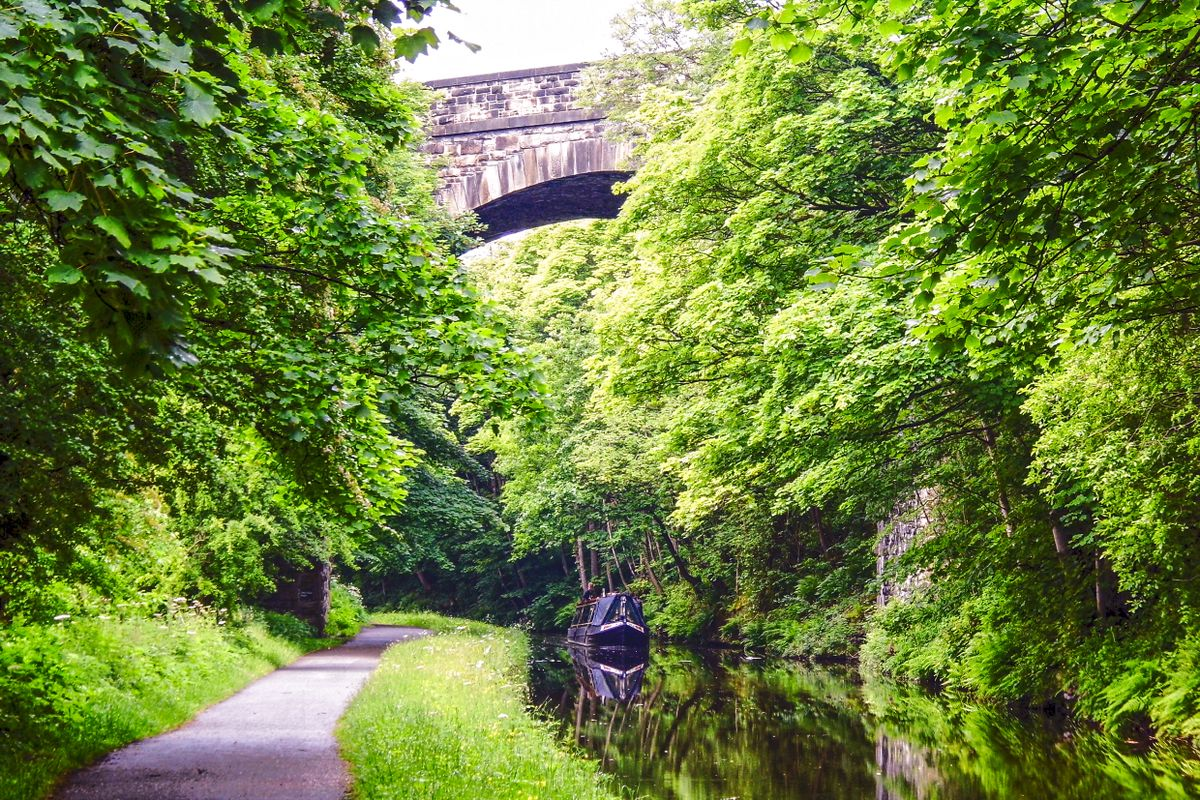 Narrowboat under Copley Viaduct.