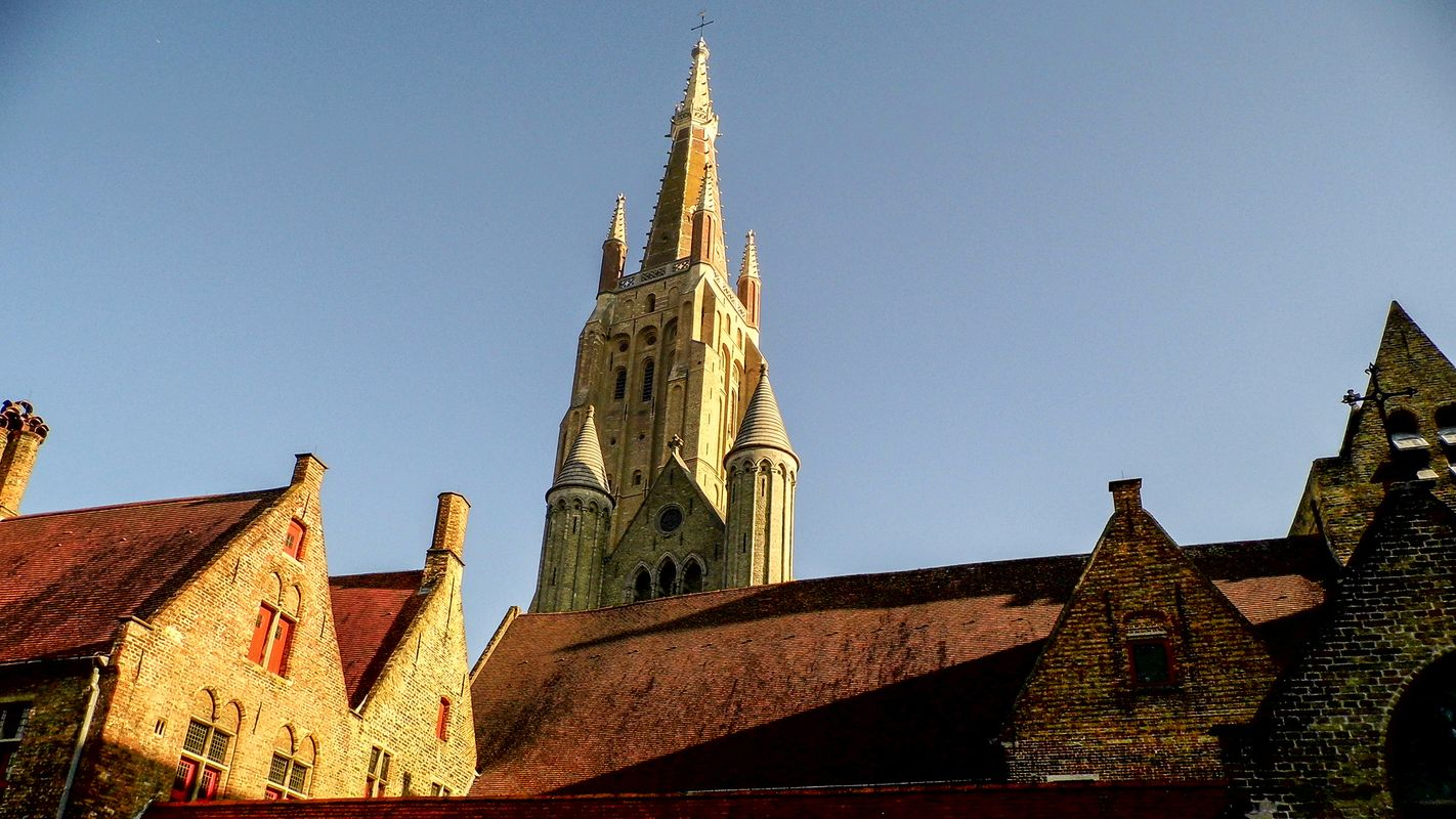 Tower Over Rooftops of Bruges.