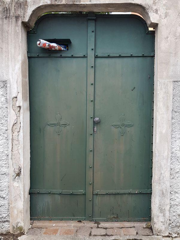 Old style green metal door