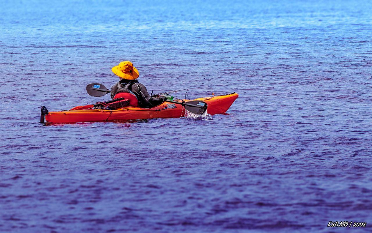 Man with Fishing Rod Kayaking