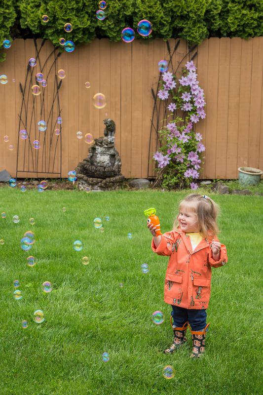 Granddaughter and bubbles- Smiles