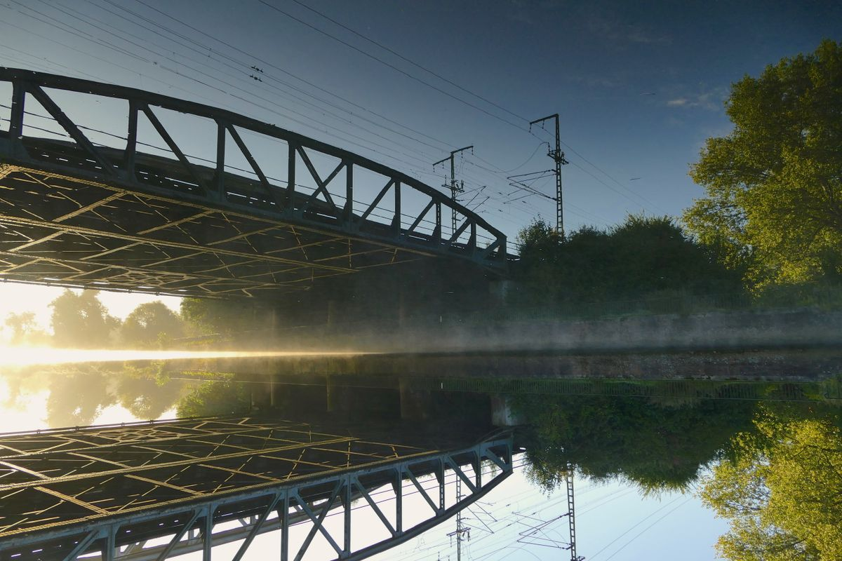 Sunrise reflecting under the Railroad Bridge