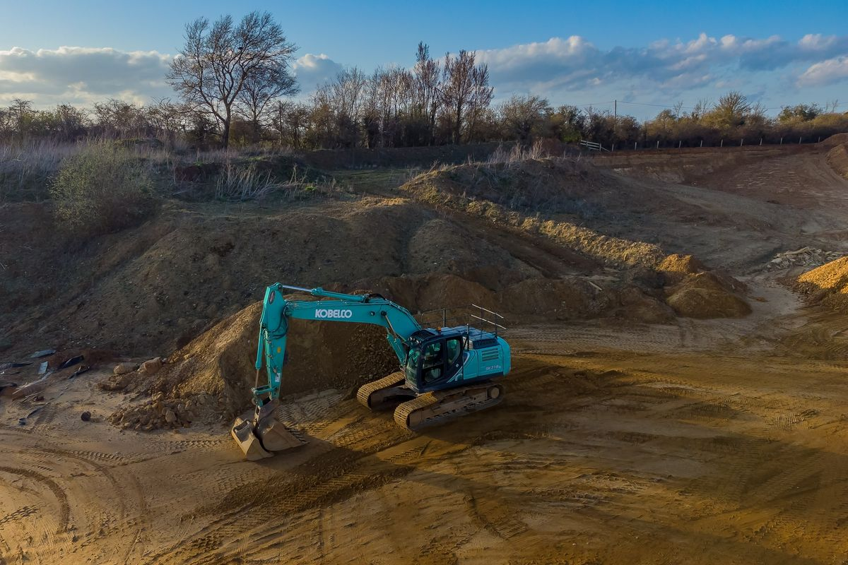 An Aerial View of a Kobelco Excavator in Duns Tew Gravel Pit, Oxfordshire