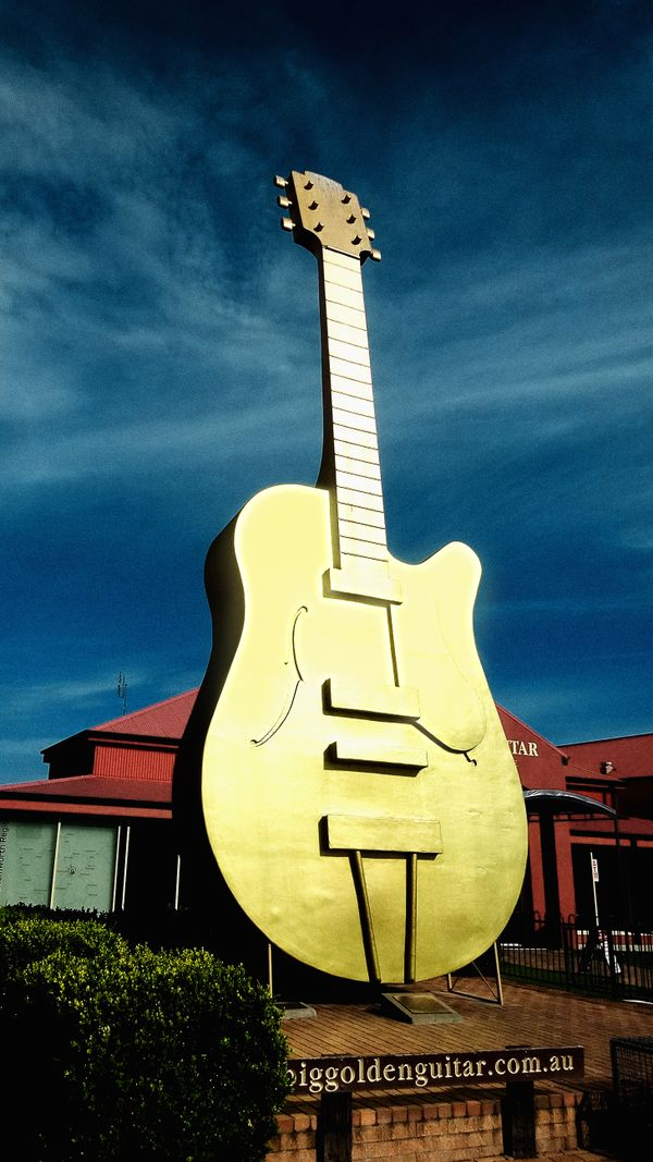 Huge big golden guitar standing on a guitar manufacturers ground in australia tamworth