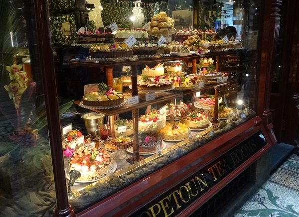Lots of delicious sweet cakes and pies in a shop window of hopetoun tea rooms in melbourne australia