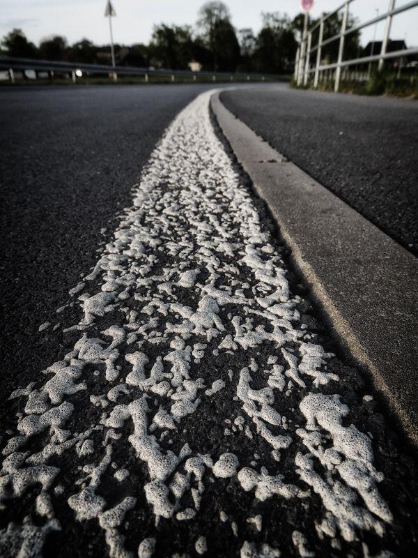 White humpy road marking lane demarcation line on a german street