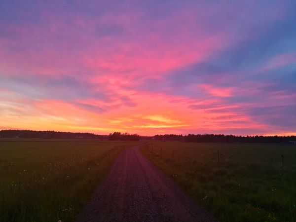 Beautiful sunset with red sky in the countryside.