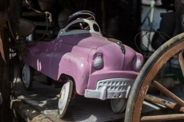 Old pink toy car