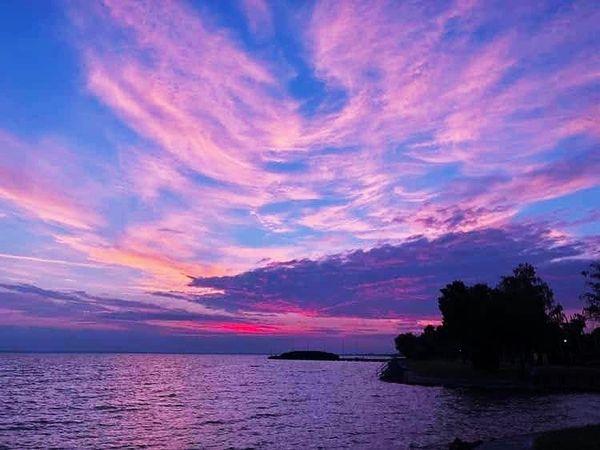 Lake and pink sunset landscape