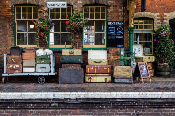 Luggage stacked up on station platform.