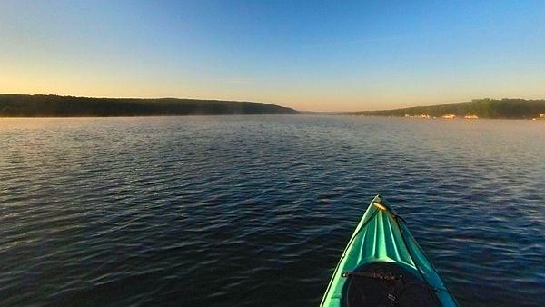 Early morning kayak on Keuka Lake in the Finger Lakes of New York USA