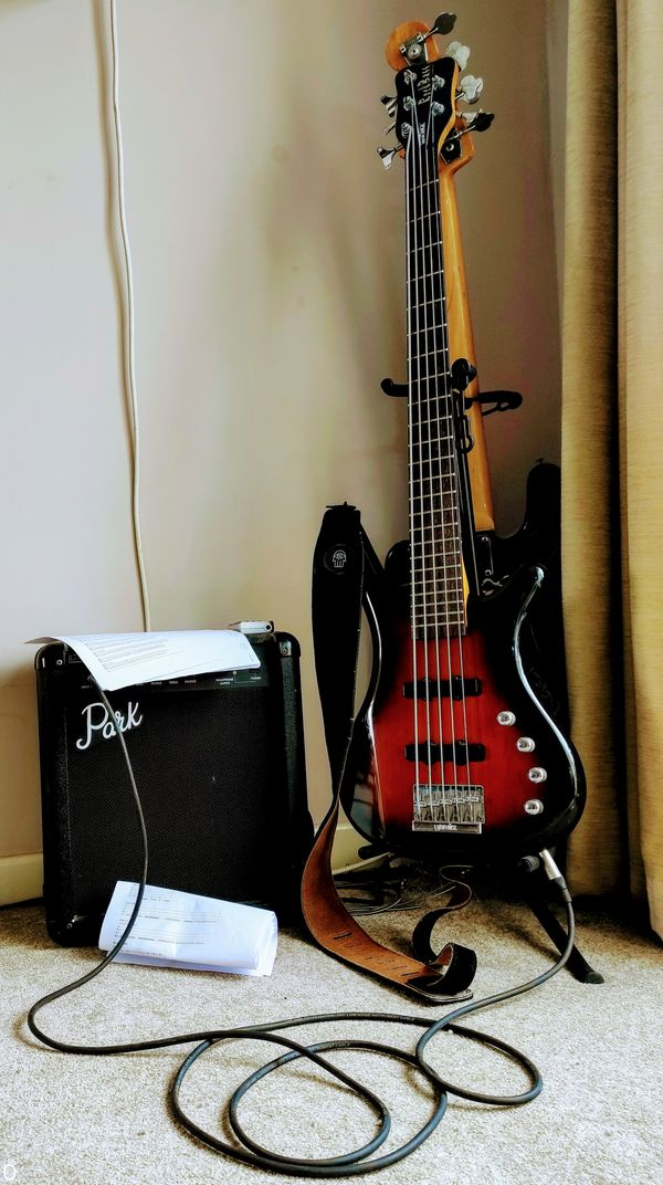 Bass Guitars on stand, and amplifier
