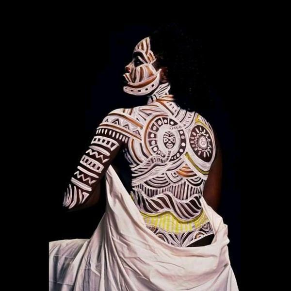 Nok art on the bare skin of an ebony girl