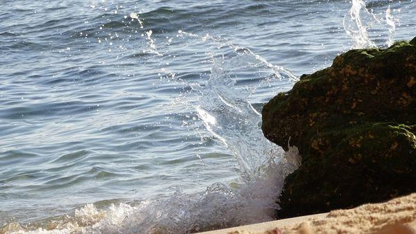 Water hitting rock