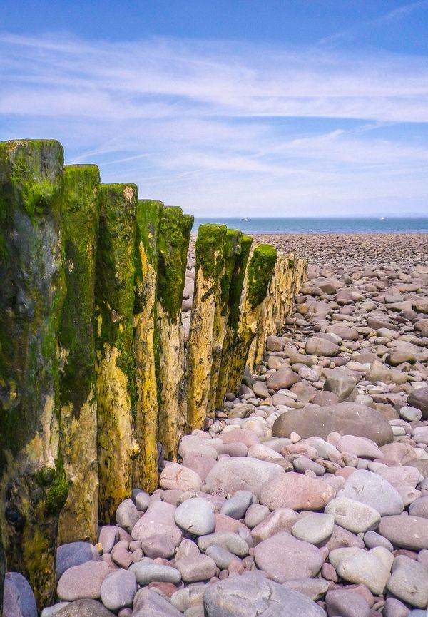 GREEN GROYNES AND SMOOTH PEBBLES PORLOCK BEACH SOMERSET