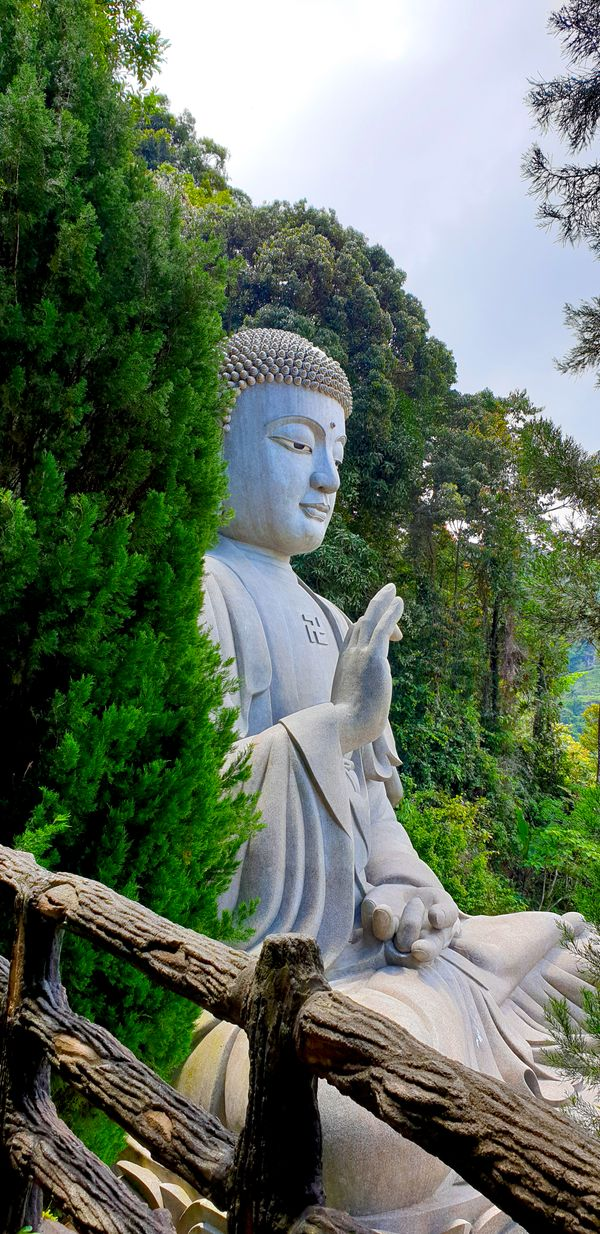 Large stone Buddha statue at Chin Swee Caves Temple in Genting Highlands, Pahang, Malaysia.
