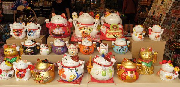 Many types of Japanese Lucky Cats Maneki Neko sitting on the store