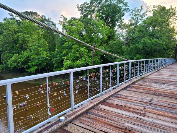 Love locks Bridge river trees