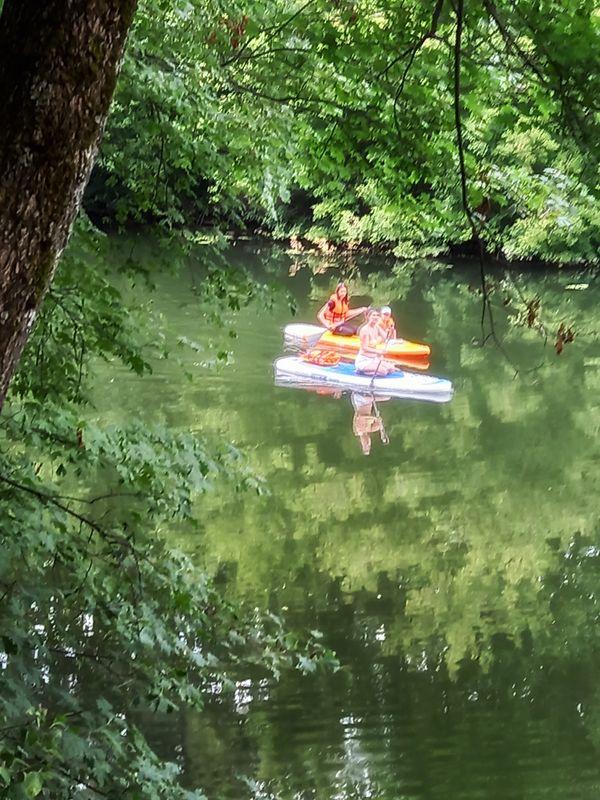 Girls floating on the river on boats.