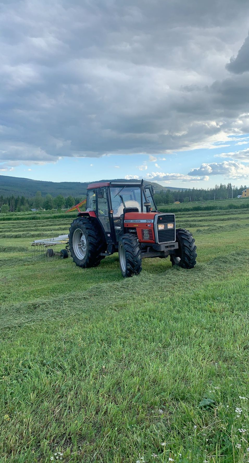 Tractor on freshly cut grass in Norway